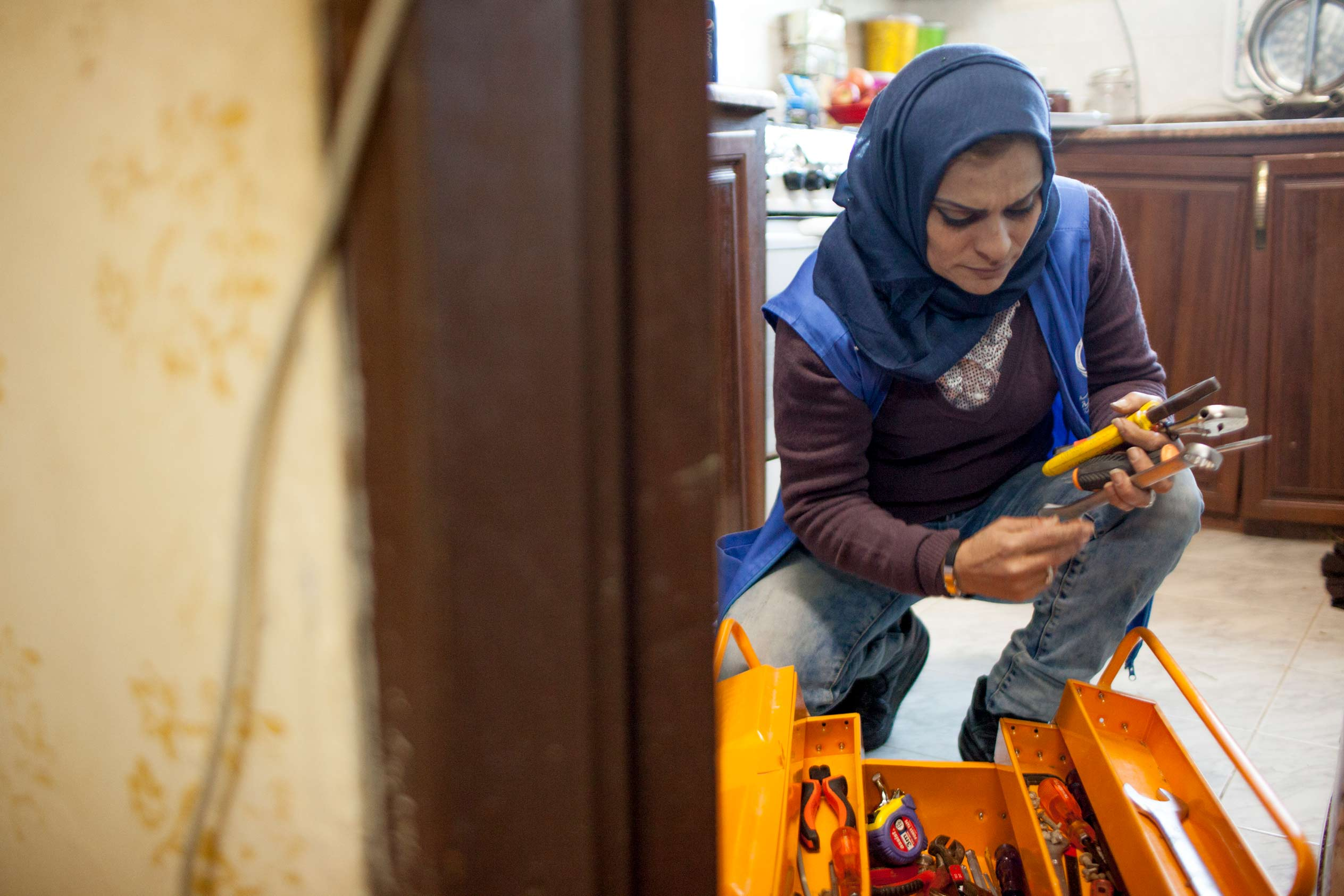 Photo: Ra'eda, pictured with her toolbox in a kitchen in Zarqa, Jordan, is one of 30 women who received training to become plumbers through a project that taught women how to effectively manage limited water resources in Zarqa, Jordan as part of MCC's Jordan Compact.