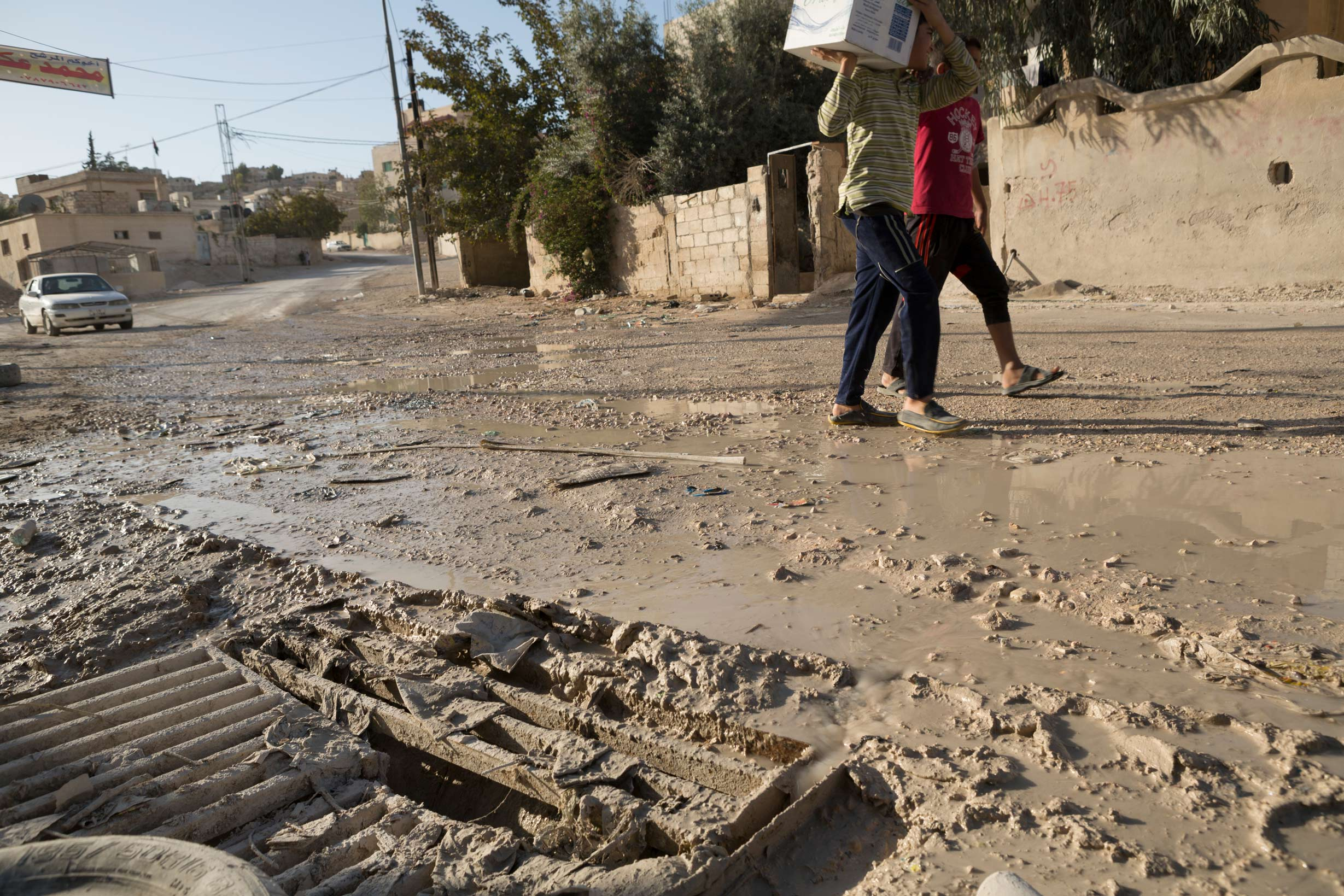 Raw wastewater overflows from sewers into the streets and neighborhoods of the city of Zarqua, Jordan in 2013.
