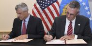 Kosovo President Hashim Thaçi, left, and MCC Acting CEO Jonathan Nash sign the Kosovo Threshold Program on September 12, 2017, in Washington, D.C. (Photo by Steve Ruark for MCC)