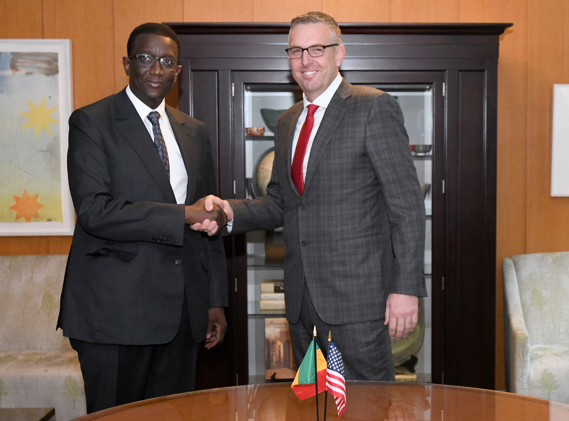 MCC COO and Head of Agency Jonathan Nash and Senegalese Minister of Economy, Finance and Planning Amadou Ba shake hands during the ceremony to mark the signing of the MCC Senegal Power Compact at the State Department.