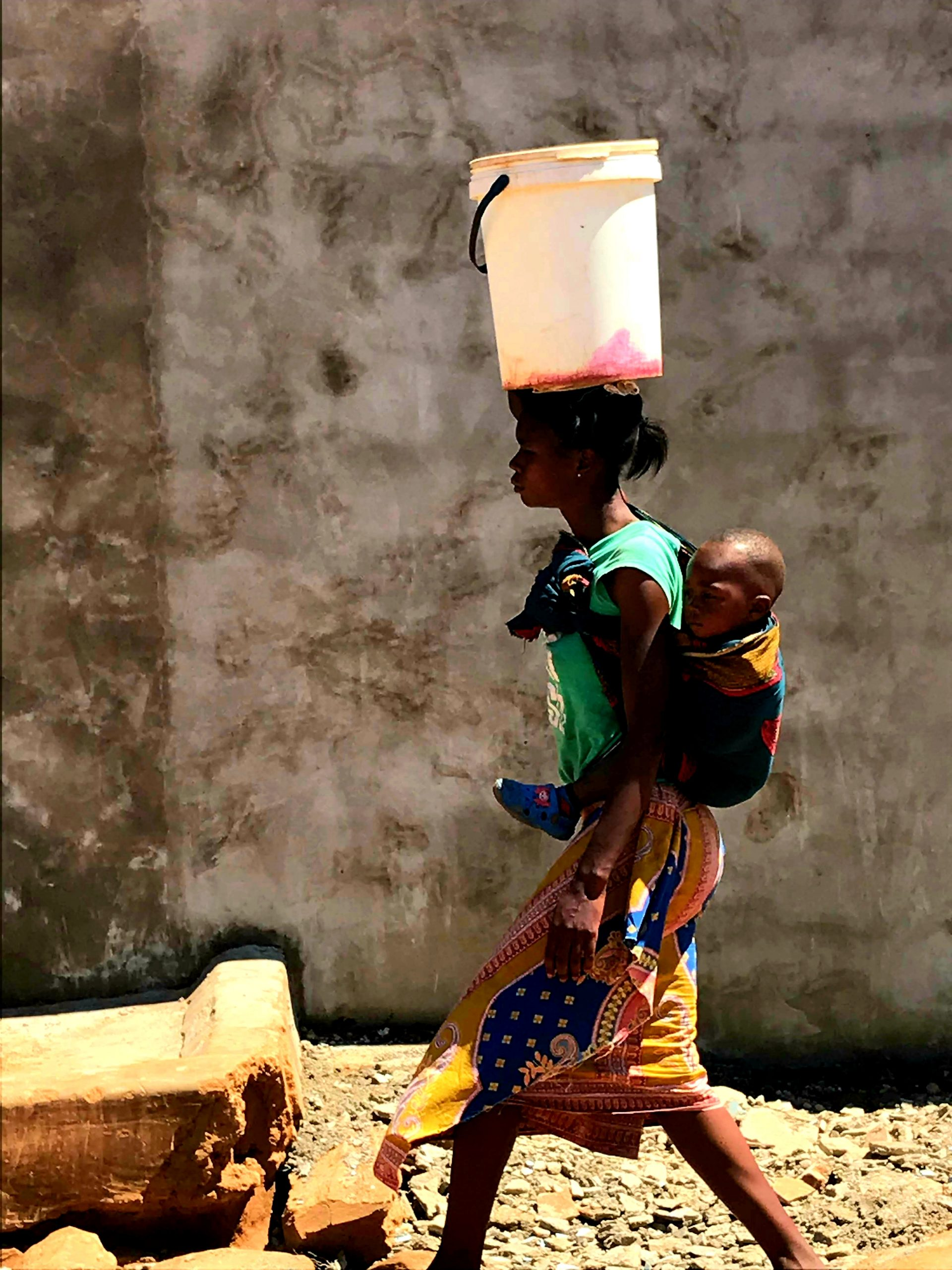 A woman walks in Jack Compound, Lusaka, Zambia.