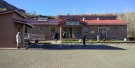 Patients and staff are seen outside of the St. Matthews Health Center in Quthing District, Lesotho.