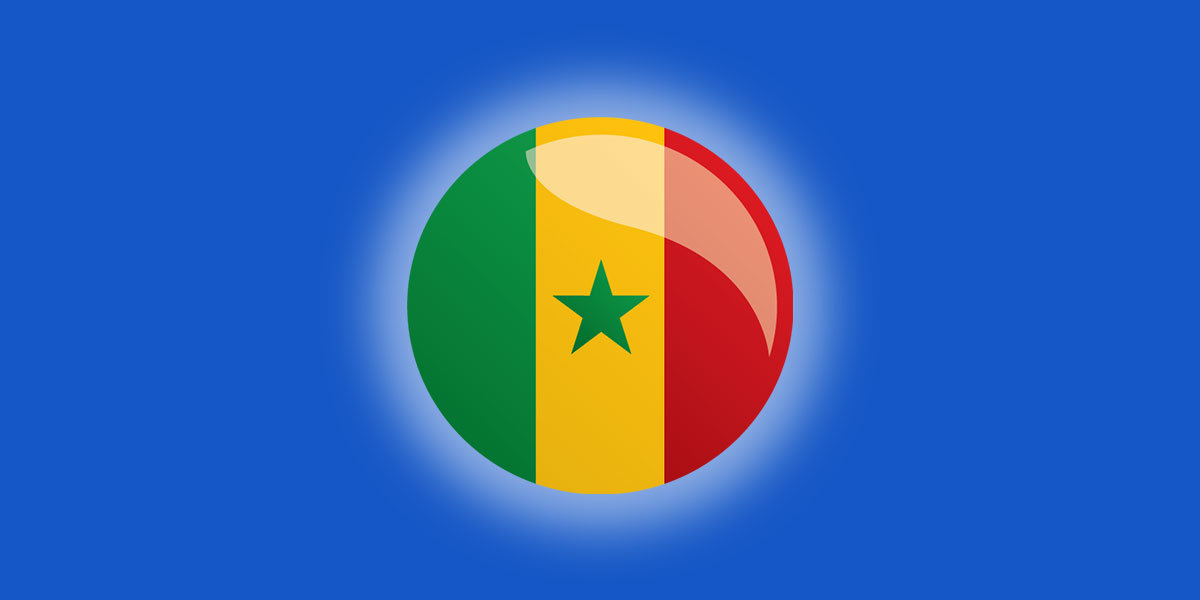 Image of Senegal's flag as a rounded button on a blue background.