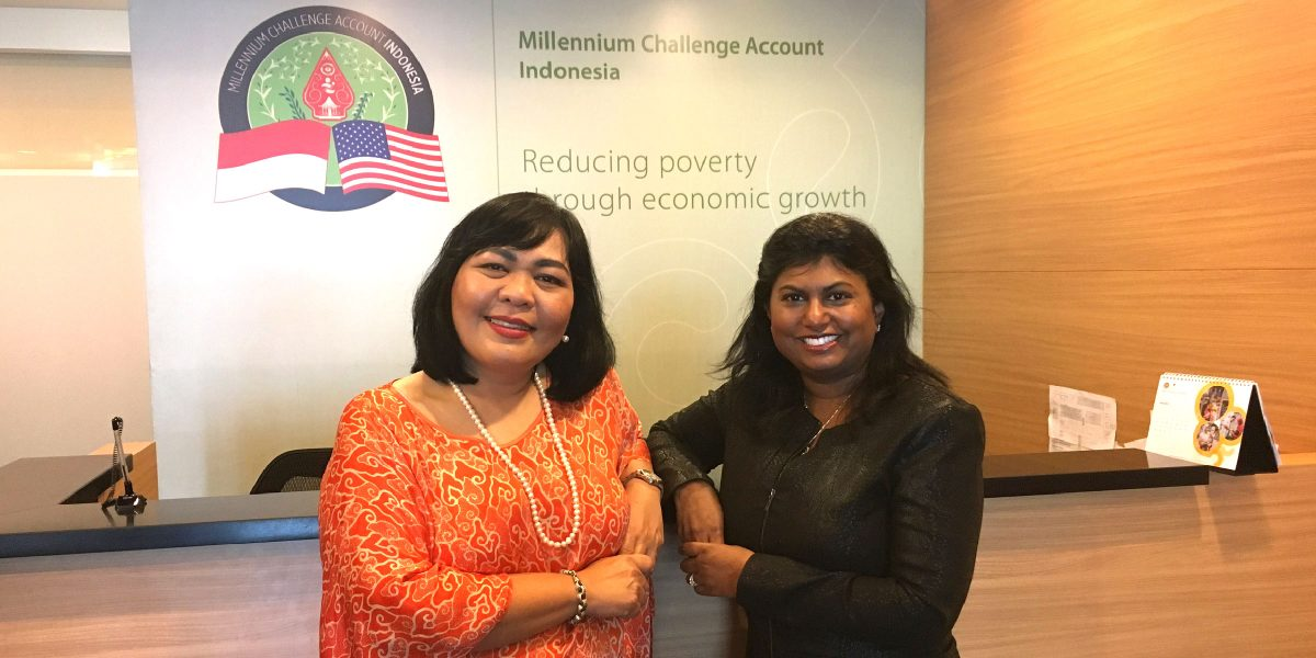 Millennium Challenge Account-Indonesia CEO Bonaria Siahaan (left) and MCC Advisory Council Member Nilmini Rubin (right) pose at the Jakarta offices of the local entity implementing MCC's Indonesia Compact. MCC-funded projects are engaging the private sector in the cocoa production and other industries to achieve better development results.