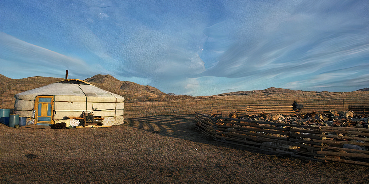 A yurt, a circular tent structure, sits near a herd of animals.