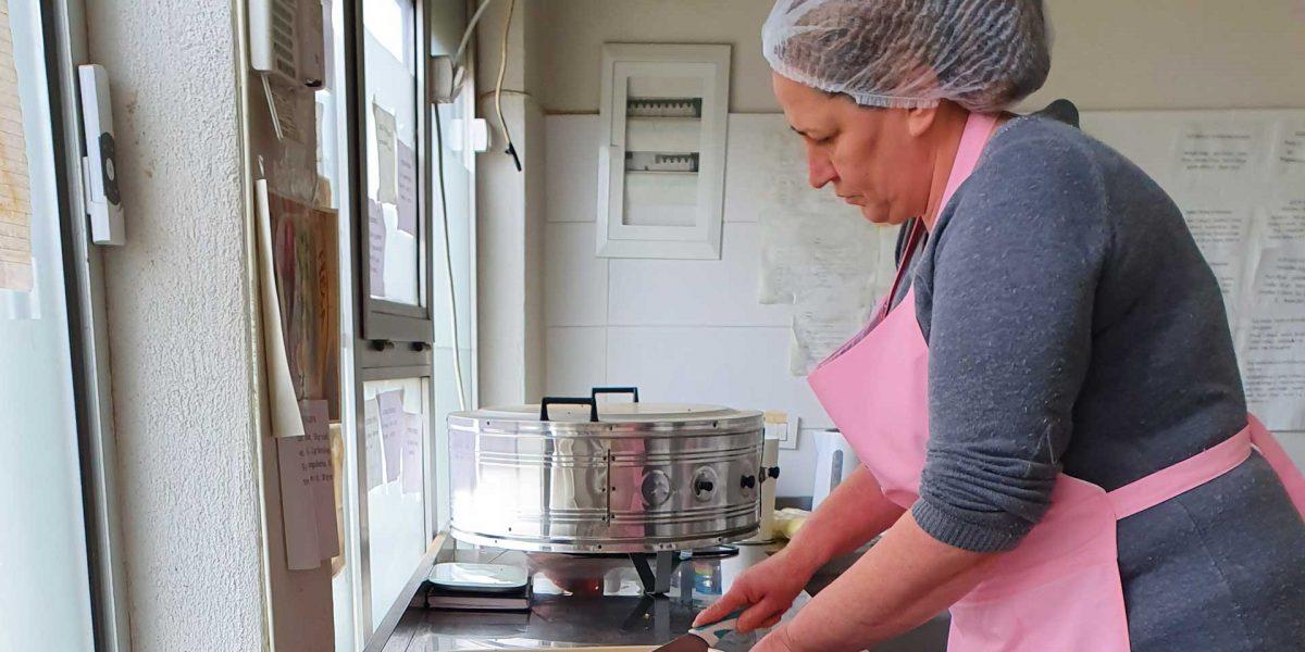 A woman Fresa employee in Kosovo preparing food.