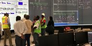 ESCOM staff demonstrate the compact supported supervisory control and data acquisition (SCADA) system for monitoring and controlling the transmission grid in Blantyre, Malawi.