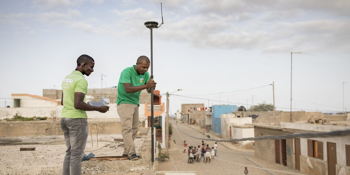 Technicians Ismael Rodrigues (left) and Jose Silva (right) work to survey and geomap a property on the island of Maio as part of the MCC-Cabo Verde Compact. Accurate information about land rights and ownership is important to facilitating private investment in Cabo Verde, where tourism is a major driver of the economy.