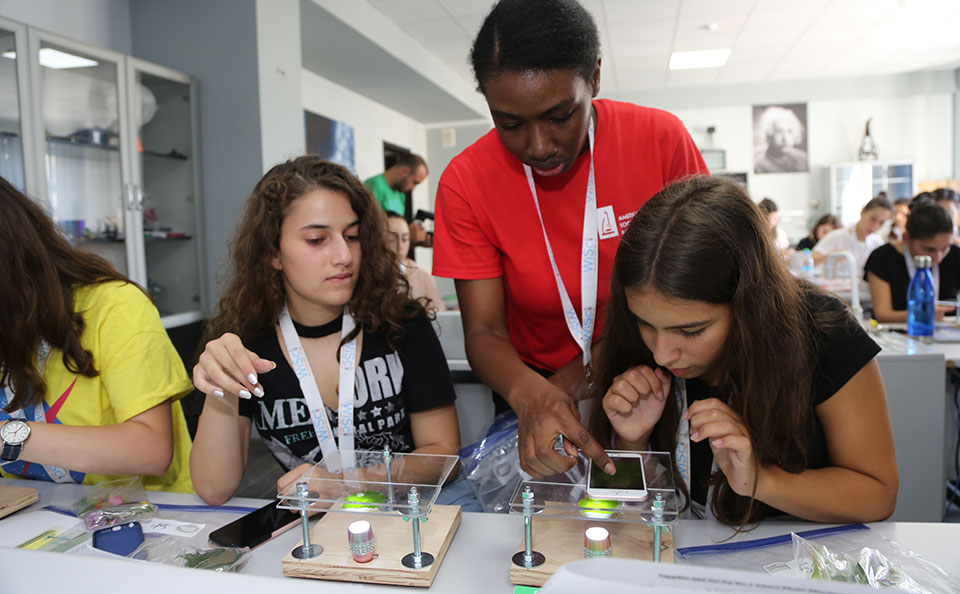 Photo: A representative of the American Society for Microbiology leads campers through an exercise where they turned smartphones into microscopes.