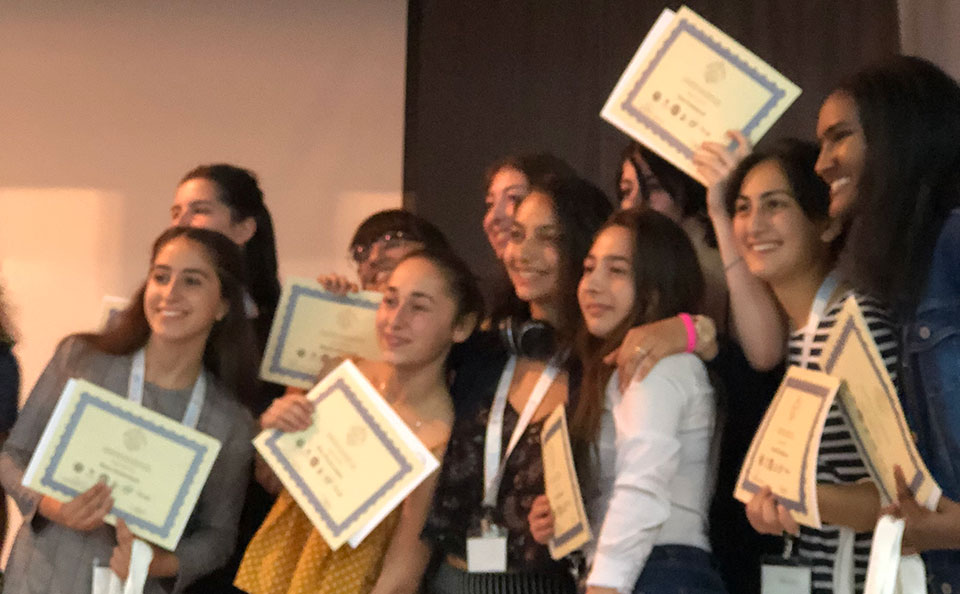 Photo of WiSci campers with their certificates of completion.