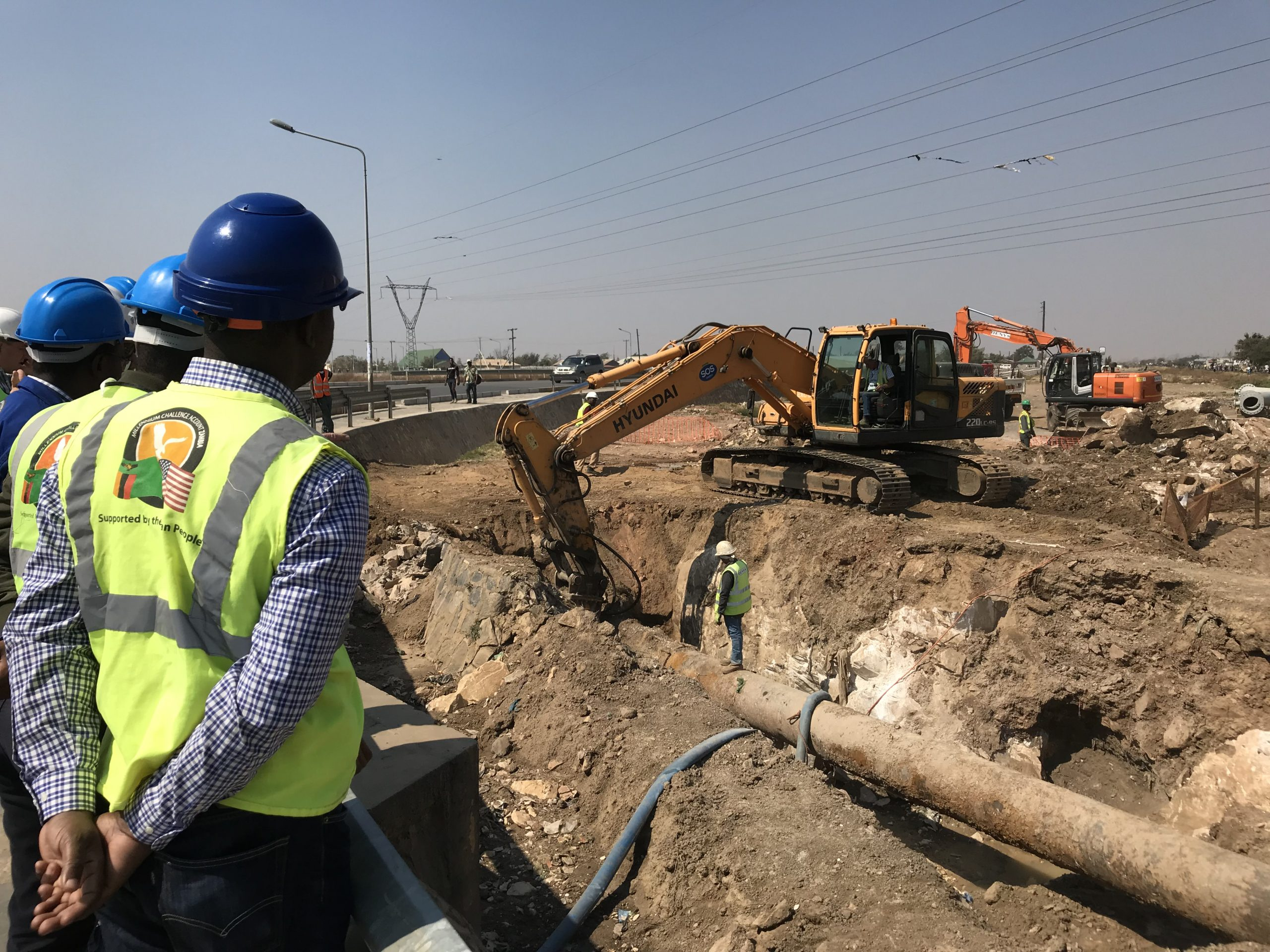 project personnel supervising pipe replacement