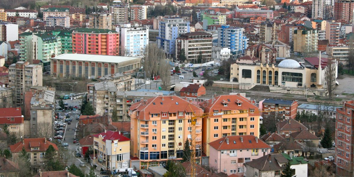 A photograph captures the northern Kosovo city of Mitrovica. MCC's new threshold program in Kosovo is designed to lower energy costs for households and businesses and support the Government of Kosovo in its efforts to improve data transparency to spur growth, fight poverty, and advance stability.