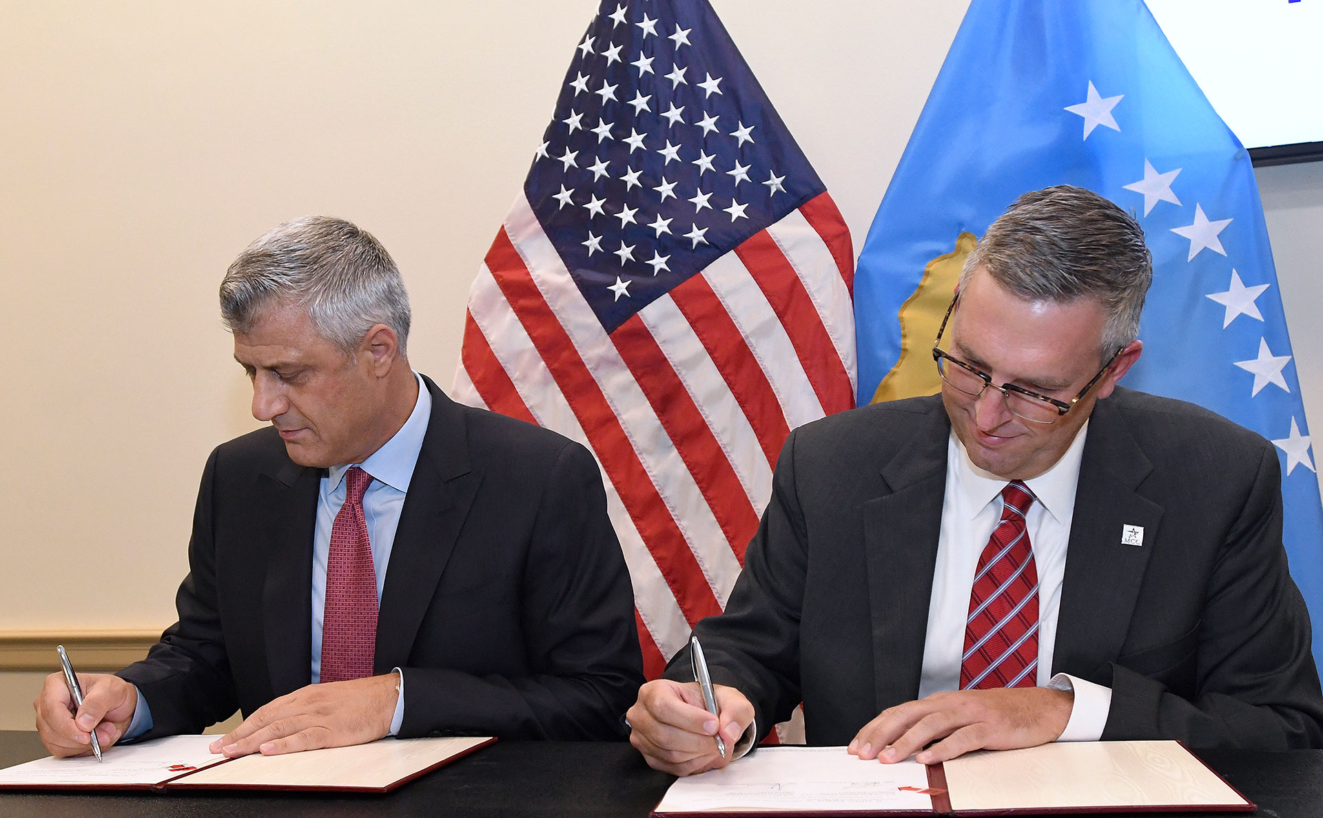 Kosovo President Hashim Thaci, left, and Jonathan Nash, acting CEO of Millennium Challenge Corporation, sign the Kosovo Threshold Program, Tuesday, Sept. 12, 2017 in Washington, D.C.