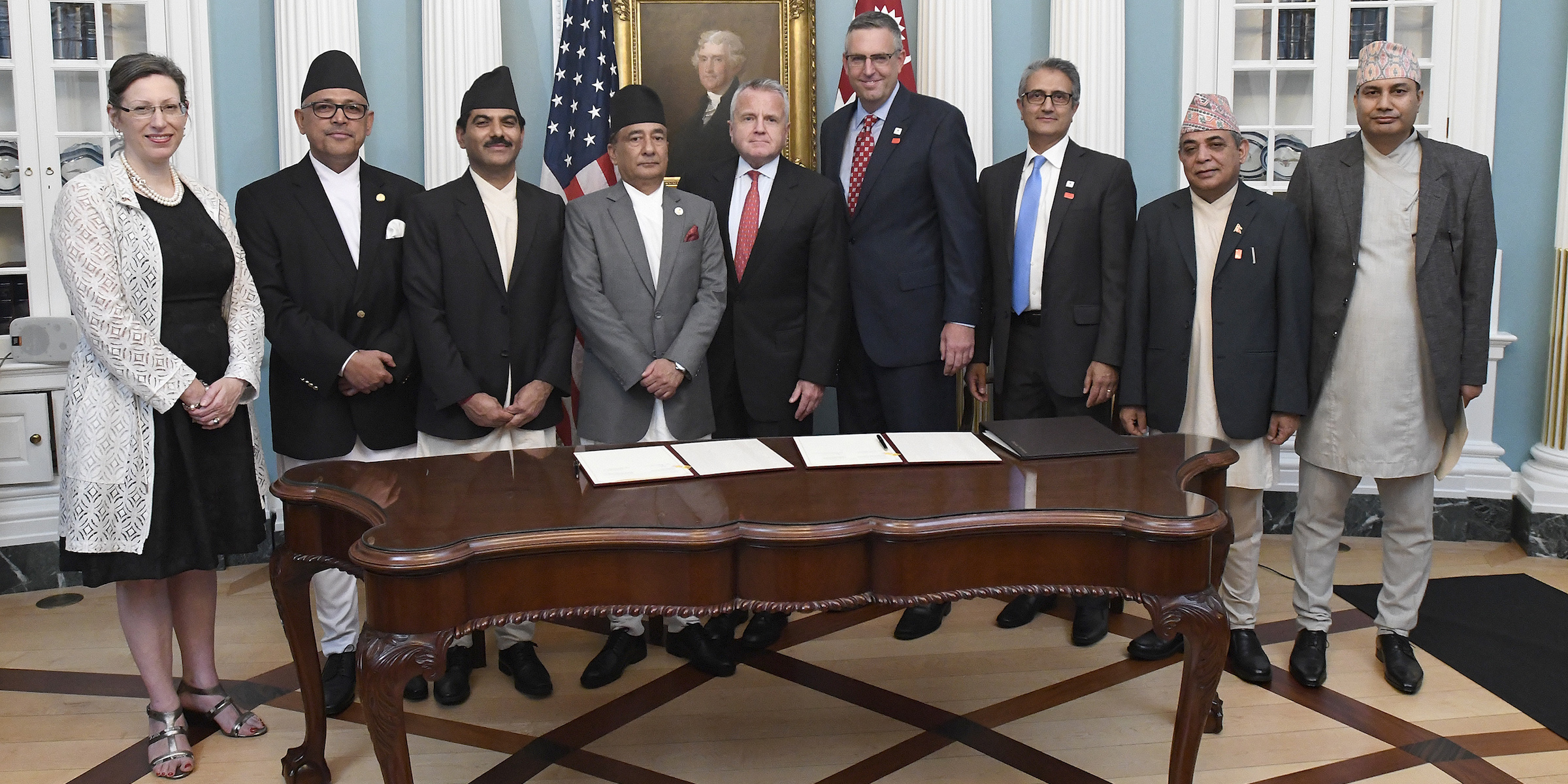 Officials gather after the signing of the Nepal Compact, Thursday, Sept. 14, 2017 in Washington.