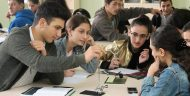 Georgian students using science lab equipment