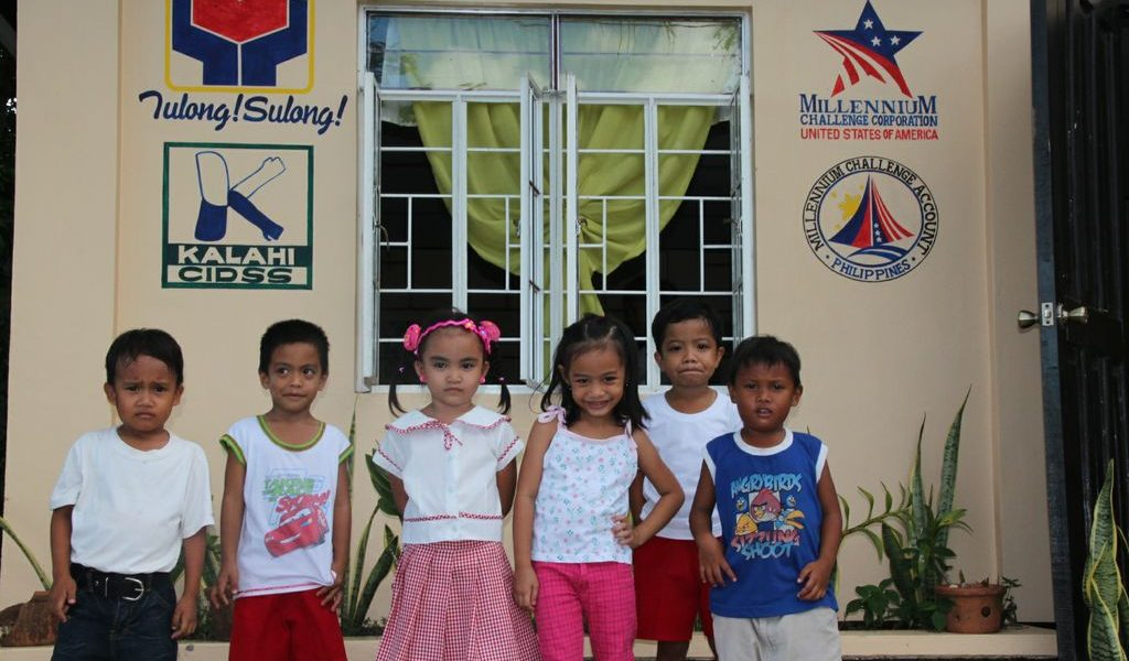 Grade school students at Bacjao Elementary School in Balangiga benefitted from two classrooms constructed under MCC's Kalahi-CIDSS project, which enhanced the learning experience and contributed to their cognitive growth.