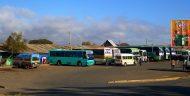 Short- and long-haul buses waiting to load passengers atthe bus station inTunduma, providing service along theTunduma–Sumbawangaroad.