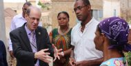 MCC Vice President for Compact Operations Robert Blau talks with Crisolita, a beneficiary of MCC's investments in water and sanitation in Cabo Verde. Crisolita now has a toilet and water in her home on the island of São Vicente.