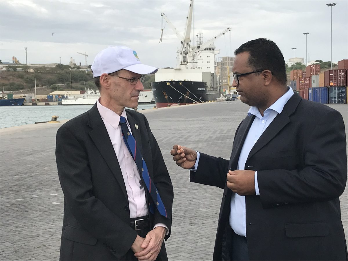 MCC Vice President for Compact Operations Robert Blau (left) and Port of Praia Administrator Celso Martins (right) discuss MCC's 2005 investments that helped expand the port, maximizing its capacity and productivity in this island nation.