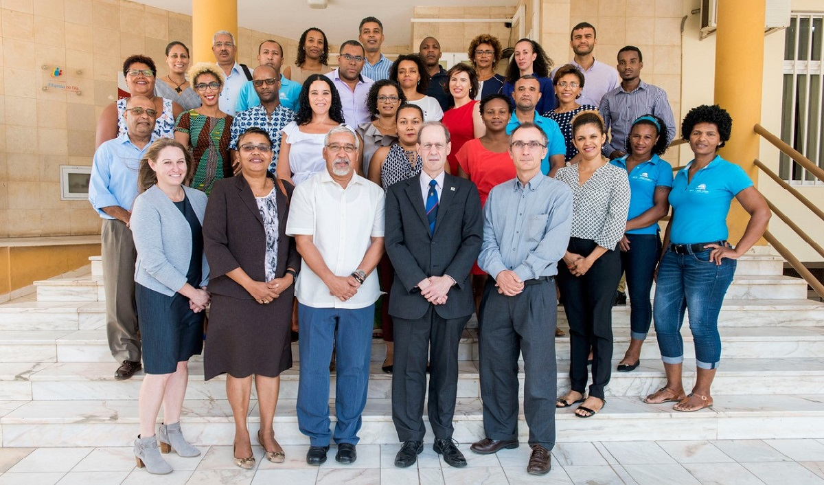 Millennium Challenge Account-Cabo Verde CEO Helder Santos (center, front row) and MCC Vice President for Compact Operations Robert Blau (right of Santos) outside of the MCA-Cabo Verde office with members of the MCC and MCA teams.
