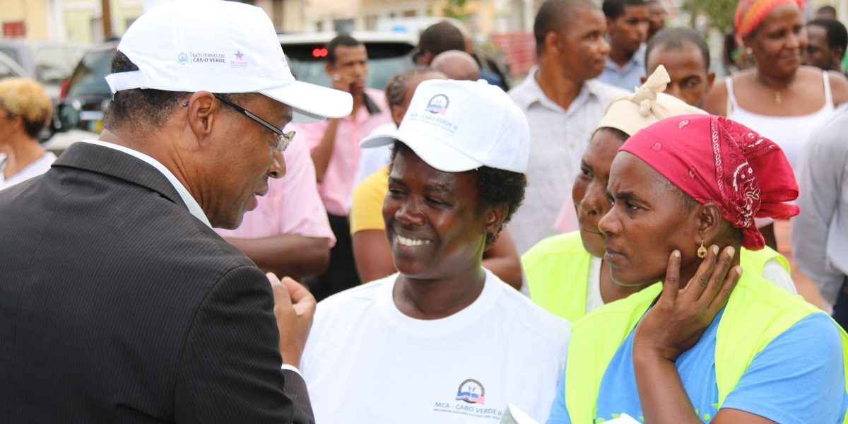 Cabo Verde Prime Minister José Ulisses de Pina Correia e Silva talks with attendees at a compact closeout celebration event in São Domingos.