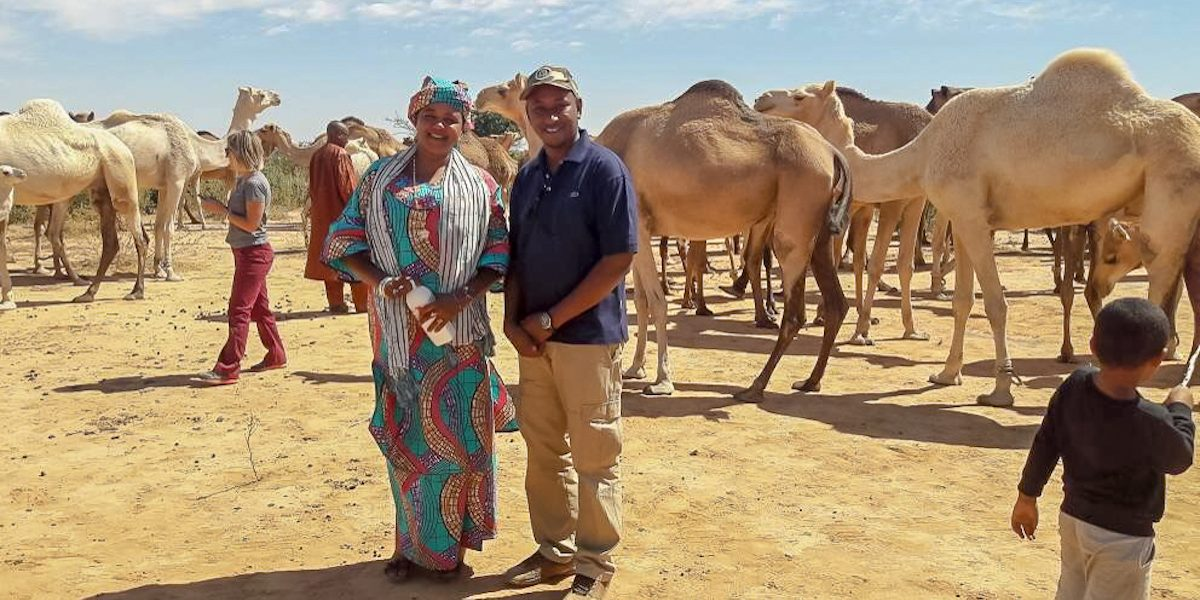 Entrepreneur Wouro Habsatou Aboubacar (left) and MCC Administrative Assistant Abderahamane Diallo (right) pose at Habsatou's camel ranch near the Youri village in Niger. Habsatou is a potential beneficiary of MCC's Niger Compact.