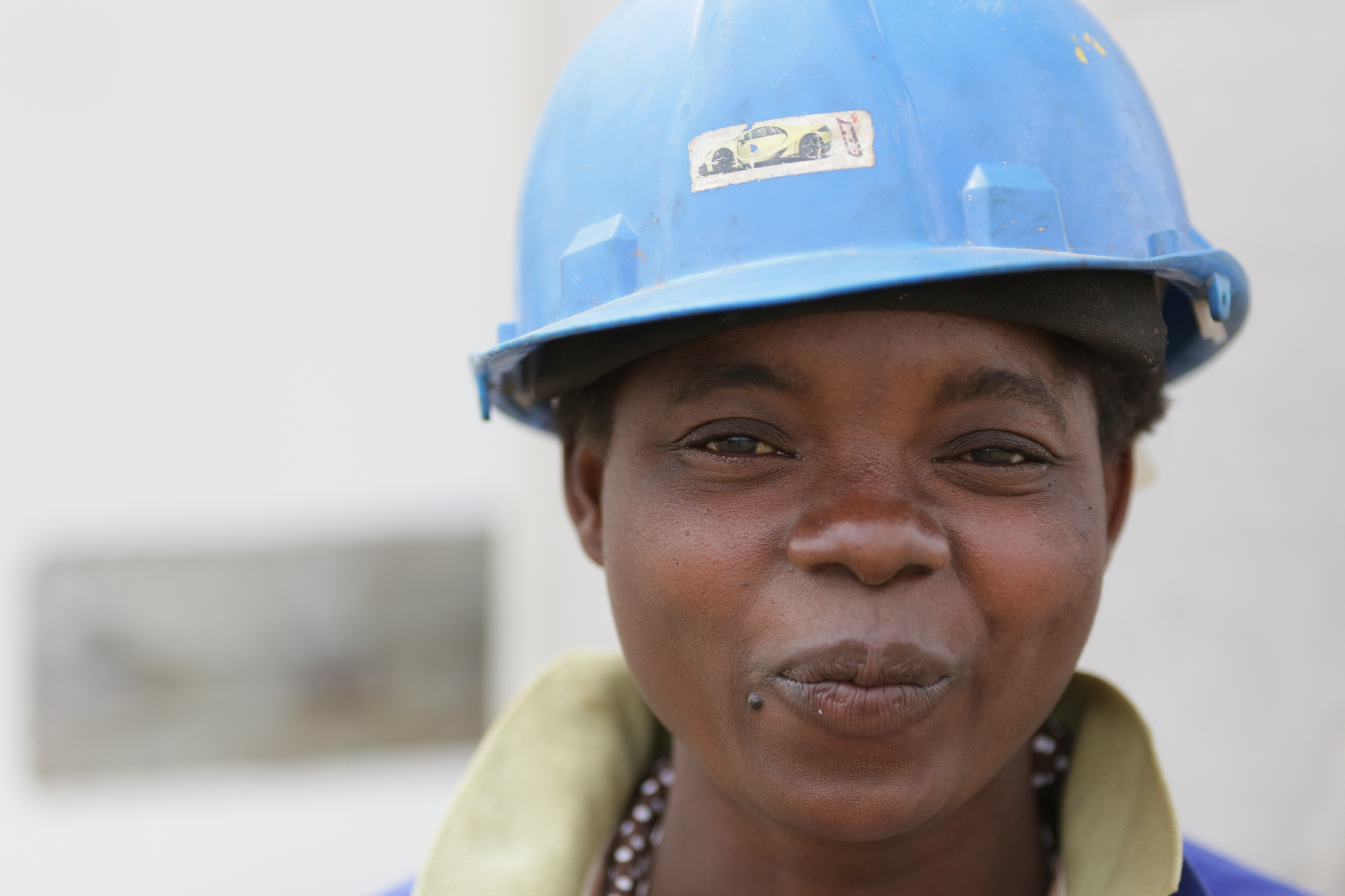 Photograph of a female utility worker