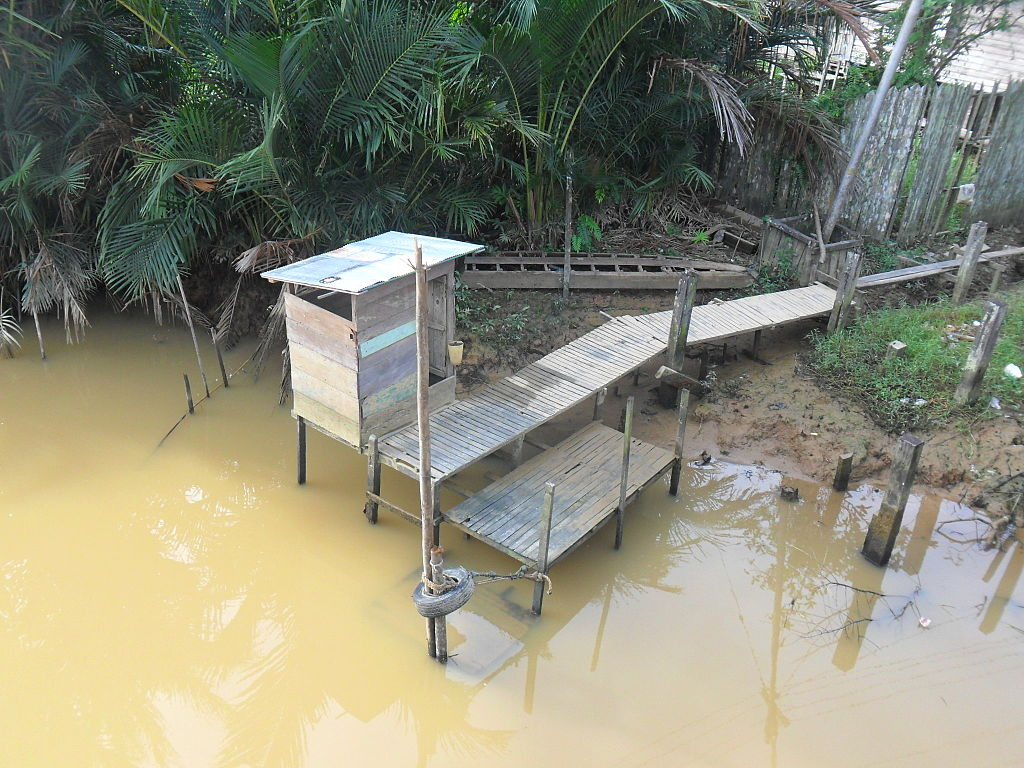 Latrines on the edge of the river in Kalimantan, Indonesia.
