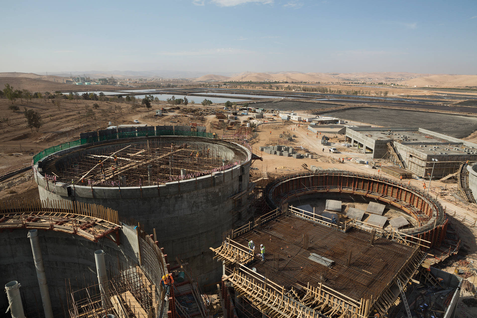 An aerial photograph shows construction of new wastewater digesters at the As Samra Treatment Plant in Zarqa, Jordan. MCC is supporting the expansion of the existing plant through a public-private partnership to increase its capacity to handle sewage and produce much needed treated water for drinking and irrigation.