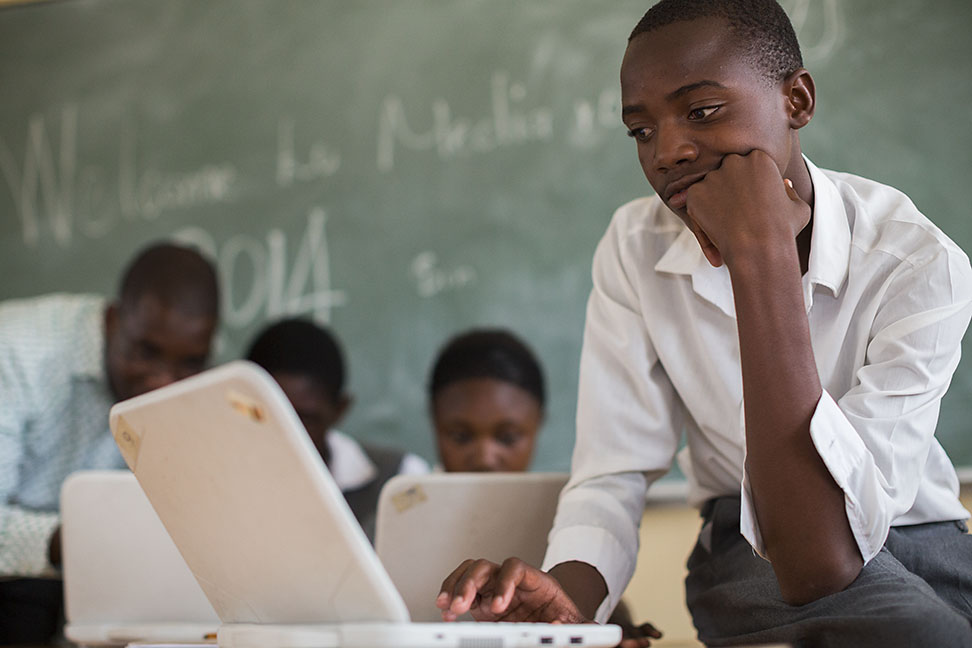 Photo: A boy works on a laptop at school in Namibia.
