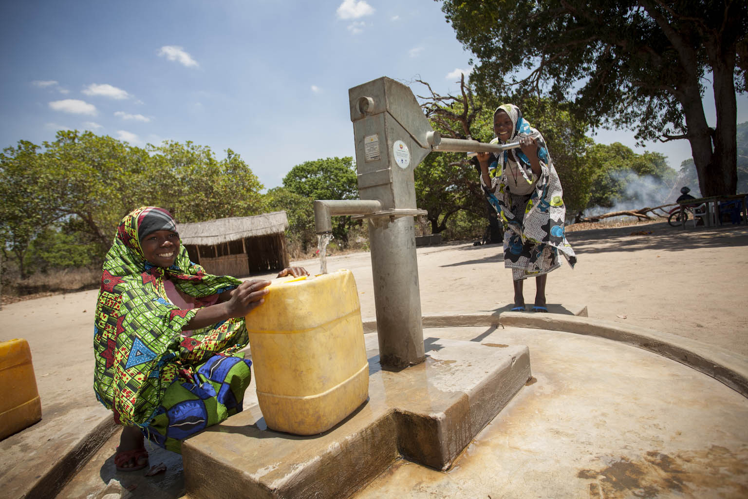Girls in a village in Mozambique pump fresh water thanks to a hand-powered water pump funded through MCC's Compact.