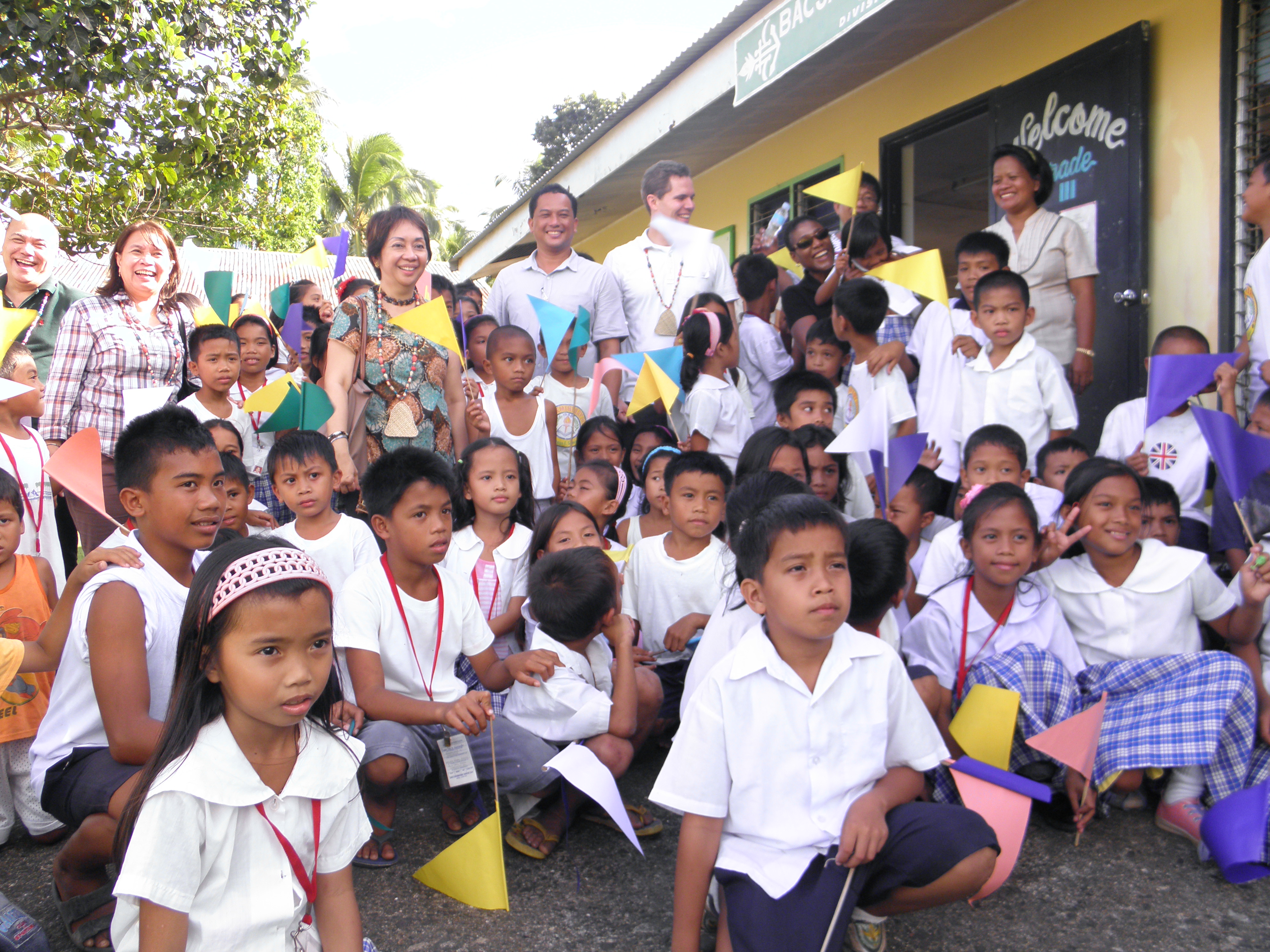 Grade school students and teachers of the Bacjao Elementary School in Balangiga, Samar welcome MCC and MCA-Philippines teams on February 28, 2012.