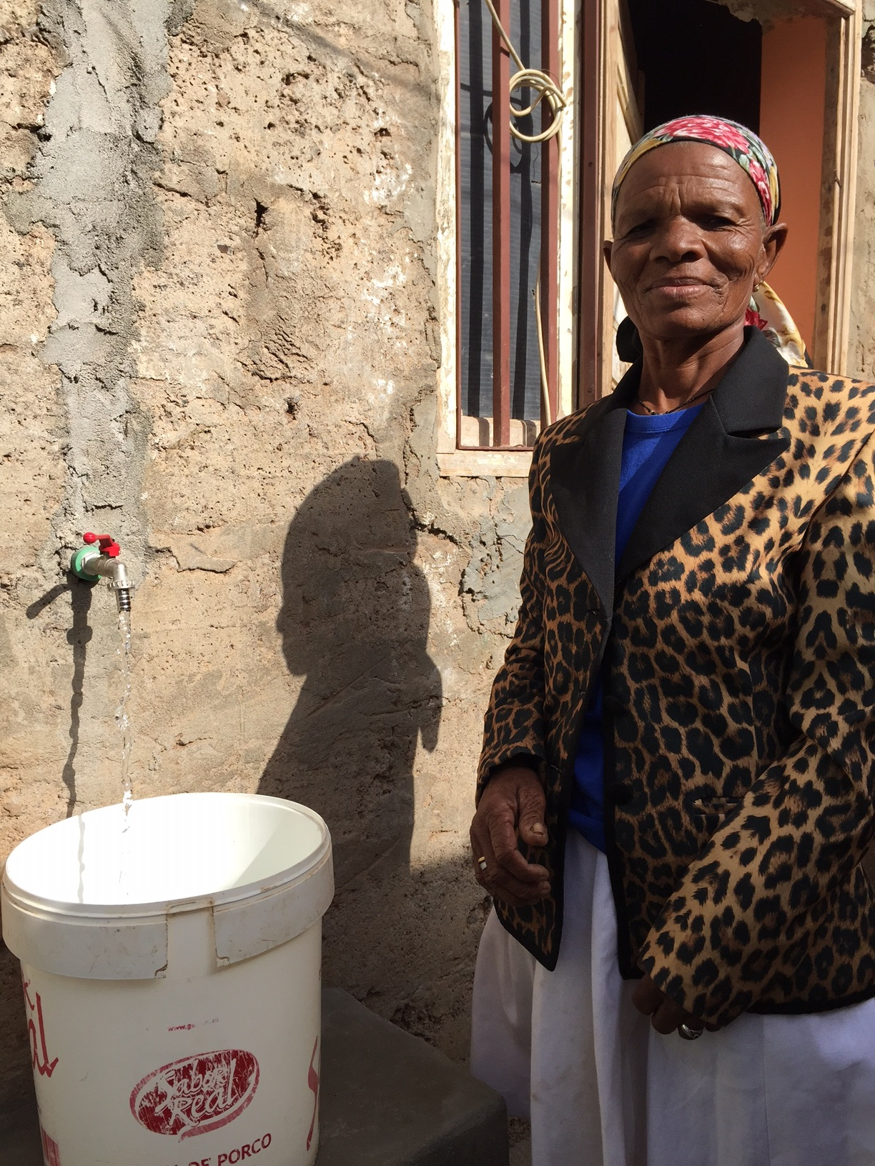 In Cabo Verde, Maria Jose, 70, enjoys running water at home for the first time.