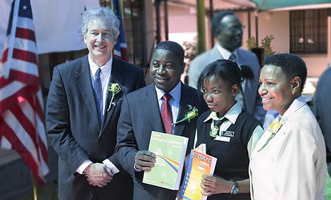 Undersecretary of State for Political Affairs William Burns, Minister for Education Abraham Iyambo, and  U.S. Ambassador Dennise Mathieu stand with a student holding her new textbook. Almost 700,000 textbooks will be delivered to 1,000 Namibian elementary schools by the end of June.