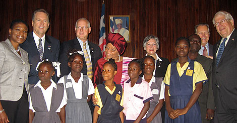 MCC Senior Advisor Cassandra Butts joins Liberian President Ellen Johnson Sirleaf, Rep. Vern Buchanan (R-FL), Rep. Mike Conaway (R-TX), Rep. Allyson Schwartz (D-PA), Rep. David Dreier (R-CA), and Rep. David Price (D-NC), and Liberian school girls currently receiving education scholarships, at the signing ceremony of MCC's $15 Threshold Program with Liberia.