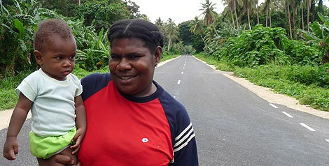 A mother from Malafau village walks along Vanuatu's MCC-funded