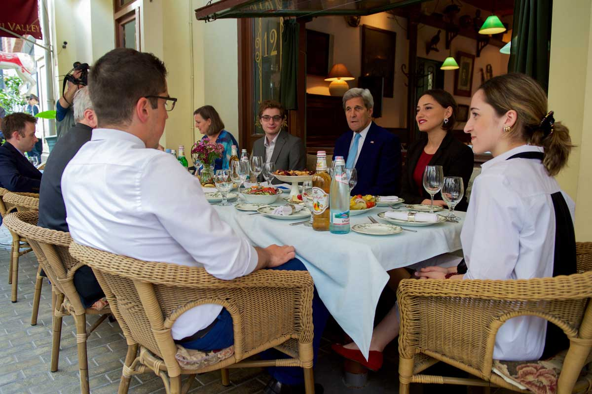 Photo: Secretary of State John Kerry (center) talks with young Georgian entrepreneurs over a meal. San Diego State University-Georgia biochemistry student and beneficiary of MCC's Georgia Compact Kesi Katsadze (head of the table) had the opportunity to join him during his July 2016 visit to Tbilisi.