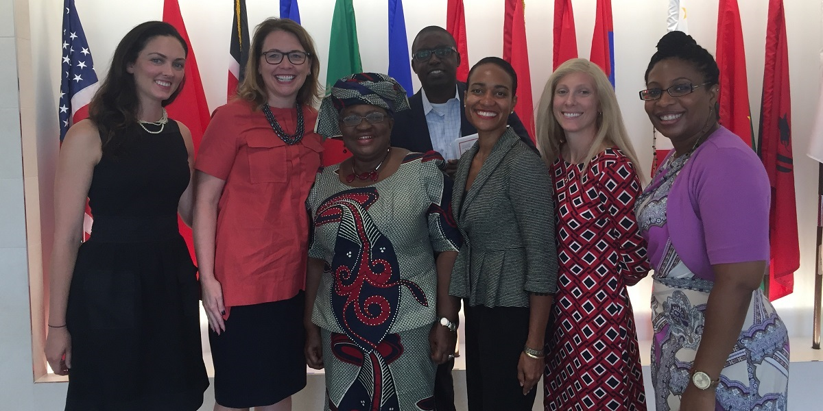 Internationally recognized development economist Ngozi Okonjo-Iweala (third from left) and MCC CEO Dana J. Hyde (second from left) pose with MCC staff following their conversation at the agency's Washington, D.C., headquarters.