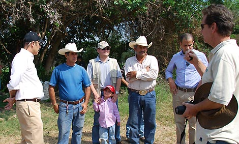 U.S. Ambassador Hugo Llorens visits farmers who tell him about the MCC-funded technical assistance that they received and adopted.